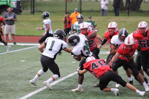 Chris Schiavone tackles a Valley Stream North player behind the line in the Knights 34-6 homecoming victory.