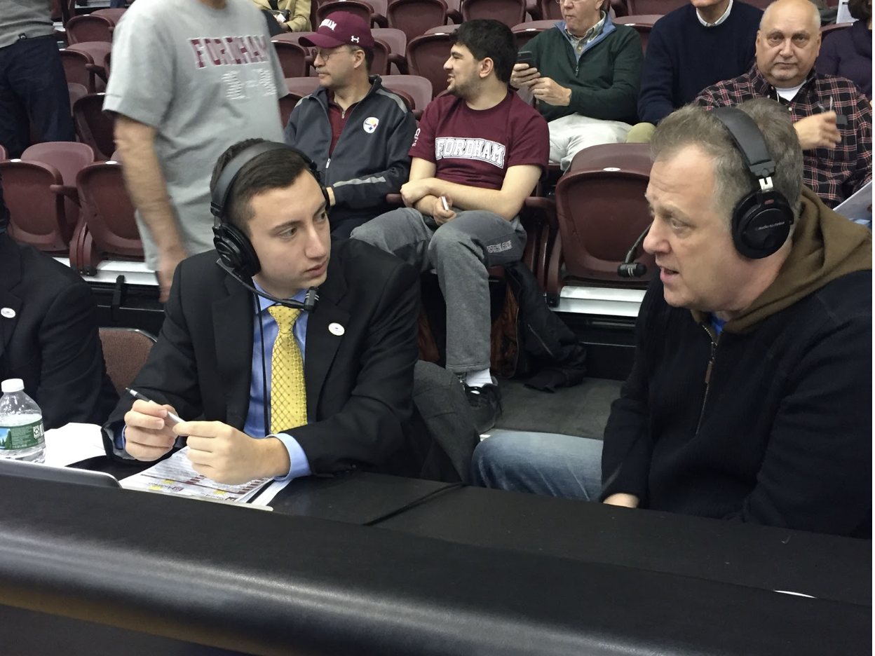 Tom Scibelli, working next to Michael Kay, the legendary New York sports broadcaster. Both Scibelli and Kay graduated from Fordham University.