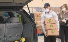 Houston Astros star third baseman Alex Bregman helps give food for the needy