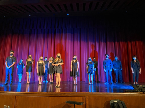 The cast of the FPM Musical performs